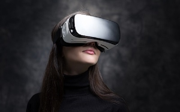 Young woman wearing virtual reality glasses